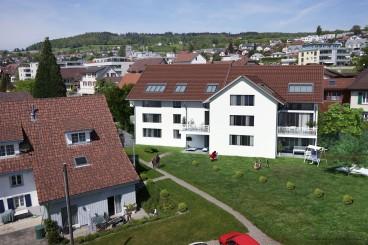5 Wohnungen, 2 Gewerbeflächen und 16 Einstellhallenplätze